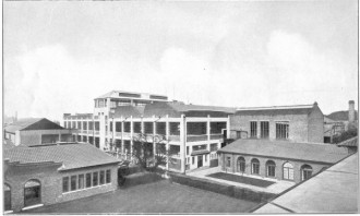 A view from the roof of the offices at Chiswick.showing Laboratories ( Left ), Men's Canteen ( Right ), with the recently added Manufacturing Departments in the centre.